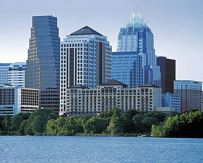 Four Seasons Hotel Austin > View across Town Lake to hotel and downtown > At Four Seasons, you enjoy a unique vantage point from which to explore the sights, sounds and experiences around you.