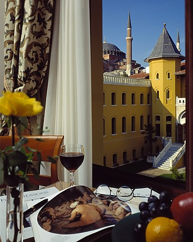 Four Seasons Hotel Istanbul at Sultanahmet > View of courtyard and Blue Mosque from only two guest rooms – foreground table-top set-up.
