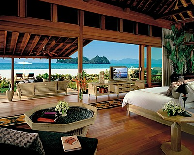 Four Seasons Resort Langkawi, Malaysia > Beach Villa bedroom. > Overlooking the azure sea with the white sandy beach a step down from the terrace, each stand-alone Family Beach Villa is ideal for families and features a quiet garden path leading to a private plunge pool and reflecting pond.
