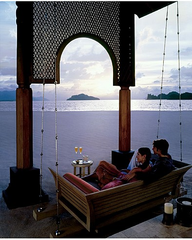 Four Seasons Resort Langkawi, Malaysia > Couple on the swing in the bar
