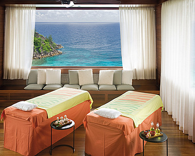Four Seasons Resort Seychelles > Spa - couples treatment room > Located at the top of the hill, with spectacular views of Petite Anse and the entire Resort, the Spa is designed with a focus on solitude and seclusion.
