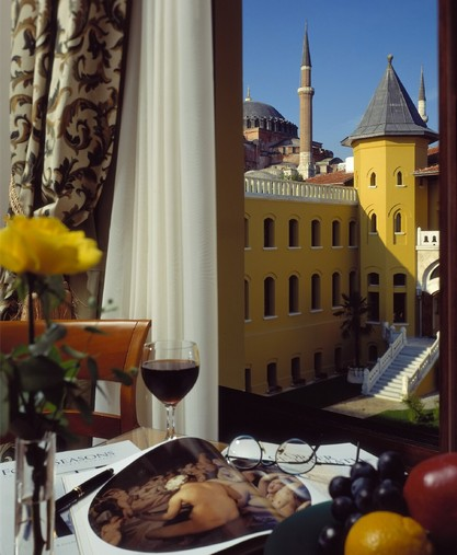 Four Seasons Hotel Istanbul at Sultanahmet > View  of courtyard and Blue Mosque from only two guest rooms – foreground  table-top set-up. > Welcome to Four Seasons Hotel Istanbul at  Sultanahmet.